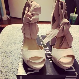 Never worn tie up blush color heels !!